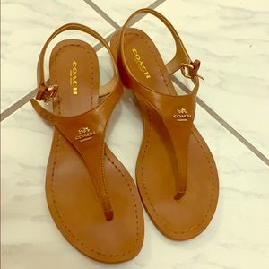 Coach tan leather sandals with one inch heels.